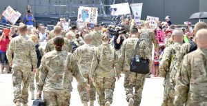 Karen, her husband Paul, and their fellow soldiers walk toward a welcoming crowd after de-boarding a plane from Afghanistan. (Submitted photos)