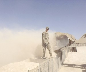 Karen's husband, Paul Brown Lucas, also a member of the 229th Engineer Company, stands atop a Hesco barrier in Afghanistan.
